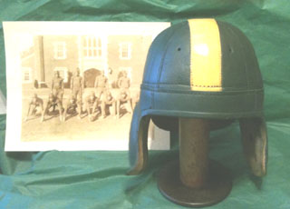 Replica leather football helmet depicting the Ducks' 1940s lids.