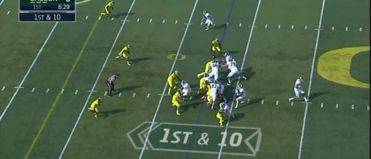 Buckner keeps Walker (#35) from being blocked, allowing him to engage the running back.