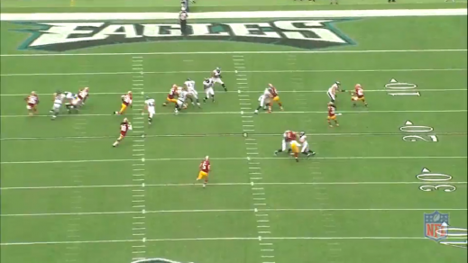 Burton (#47) and Brandon Graham (#55) pull to the right to give Polk (#32) and lead blocker Brad Smith (#16) a hole to run through.