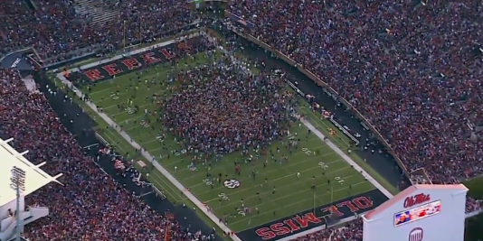 Ole Miss fans stormed the field after their 23-17 upset win over Alabama.