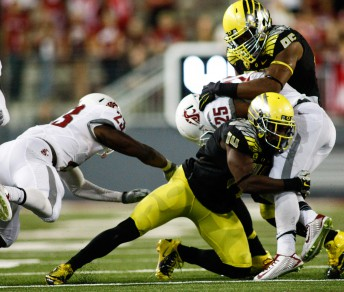 Oregon defenders make sure a Washington State player goes no further