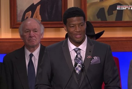 The gentleman on the left seems unimpressed with Winston's bragging during Heisman acceptance speech.