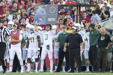 "Chip Kelly added more tempo to Oregon's offense by using signs to ""call the plays."""