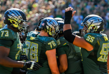 Oregon lineman celebrate after a touchdown.