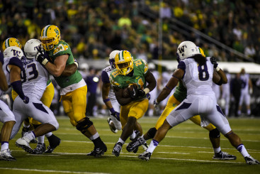 Royce Freeman powers his way through the middle.