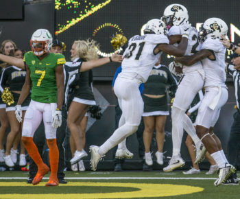Colorado players celebrate their game winning interception against Oregon